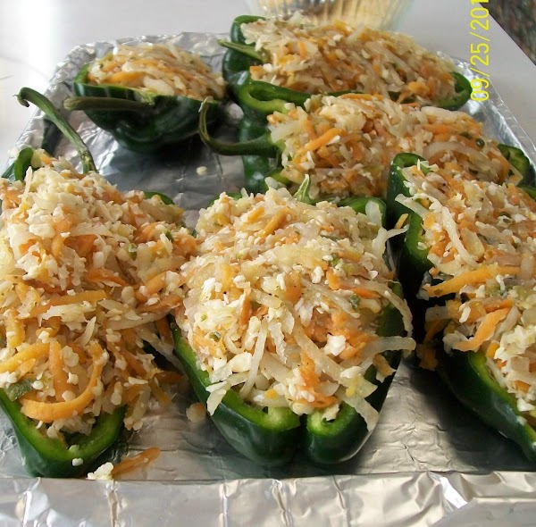 Slice the peppers in ½ lengthwise and clean them then fill the peppers with...