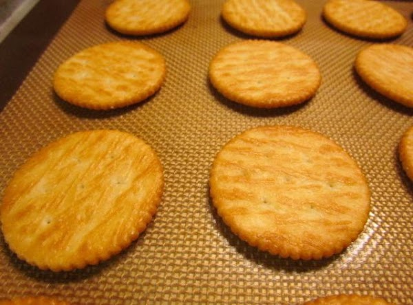 On a cookie sheet place your ritz crackers salty side down.