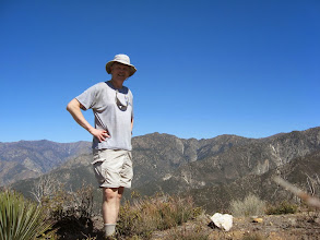 Photo: Yours truly, Dan Simpson, atop Sunset Peak. Iron Mt. (8007') is right in front of me.