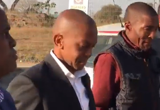 WATCH | Fraud accused lawyer hands himself over to police