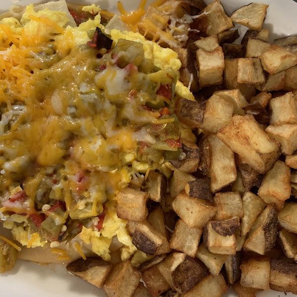 Breakfast Enchiladas with Potatoes  Mmmmmmm.  Can't get better than this.