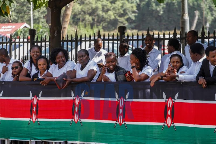 Kenyans wait to view the body of the late and retired President Daniel Moi.