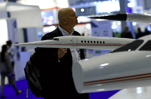Resistance: A visitor looks at the AS2 supersonic business jet replica on the Aerion Corporation booth during an aviation exhibition in Geneva, Switzerland. Picture: REUTERS