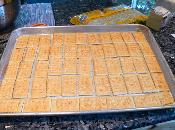 Lay Keebler's Club original butter crackers over the bottom of a cookie sheet. Cover...