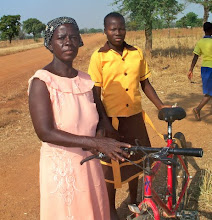 Photo: Avorrake lives in the village called Kandiga, in rural northern Ghana. Avorrake will use her bike to improve her business selling Patasi, a beverage she makes and sells at community events.
