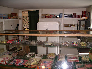 Photo: the candy counter. Through the curtain one can glimpse the owner's kitchen. there are photos of it in the 1940's kitchen album