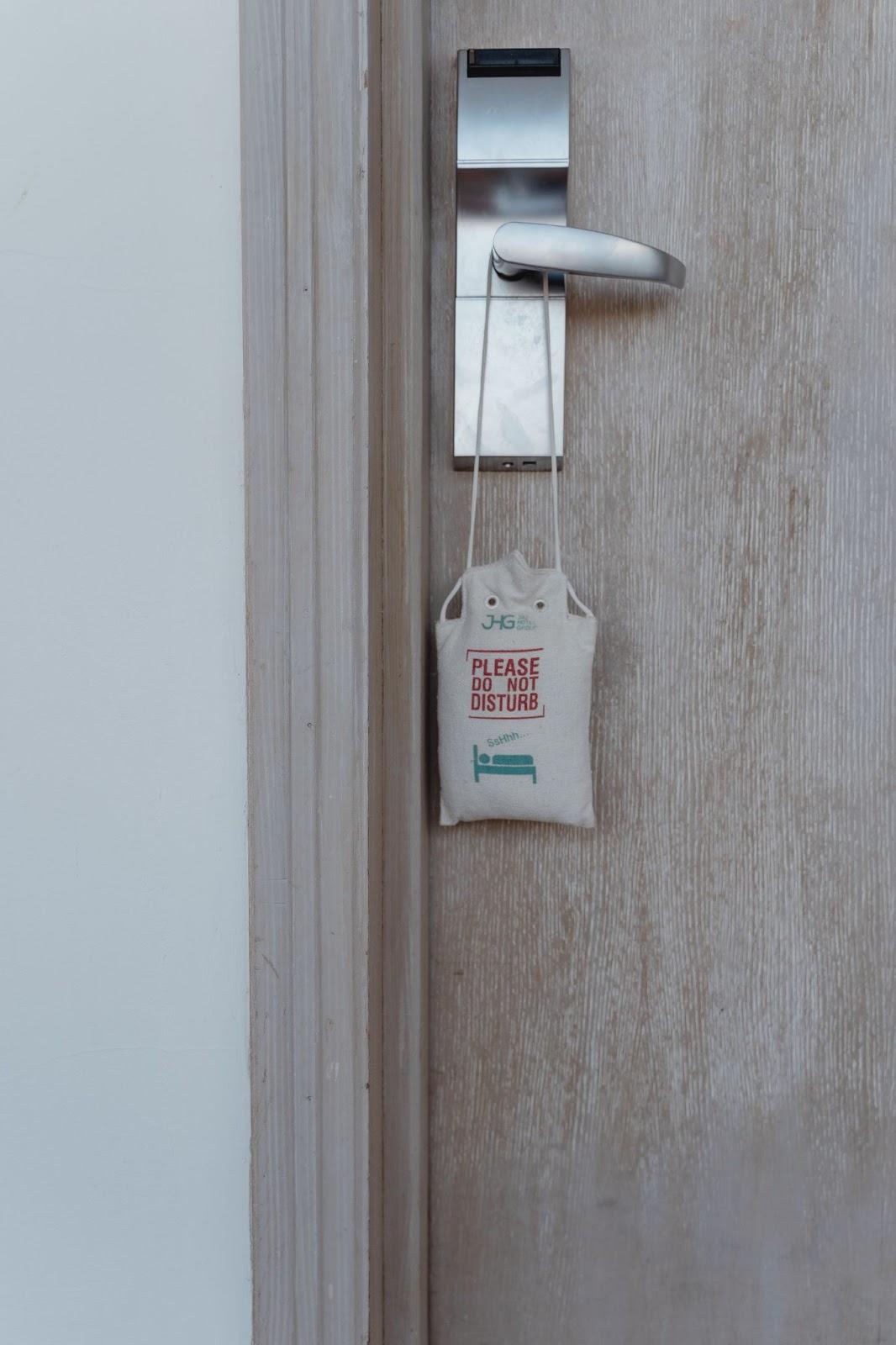 Door hanger bag on a hotel door