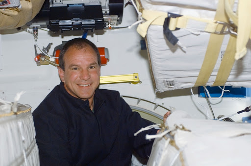 Commander Bloomfield poses on the middeck of Atlantis during STS-110