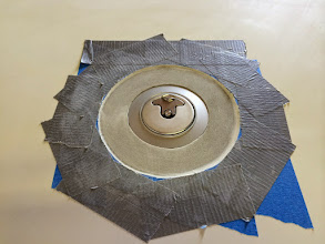 Photo: Fuel caps cut in and taped off.  The aluminum cap flange was drilled around the circumference before floxing and glassing them in place.