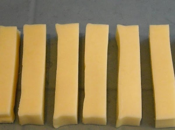 Cut Brick of cheese into 1/4 Sticks  (Similar to picture. Or any other shape...
