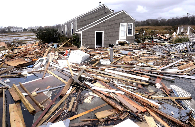 Photo: Debris floats around a house pushed off it's foundation in the aftermath of superstorm Sandy in East Haven, Conn., Tuesday, Oct. 30, 2012.  Sandy, the storm that made landfall Monday, caused multiple fatalities, halted mass transit and cut power to more than 6 million homes and businesses. (AP Photo/Jessica Hill)