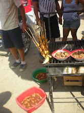 Photo: Fat, juicy worms for sale both live and grilled