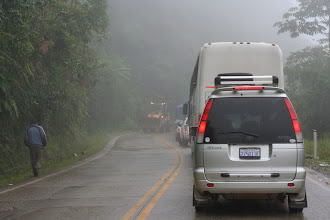 Photo: This photo sums up a lot of what the first half of the drive was like:  fog, bus/truck traffic, and slow going due to landslides, all on a steep drop into the jungle.