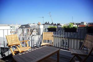 Exposed wooden beams and a roof deck St Germain 2 bedroom