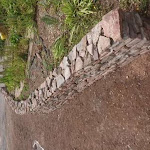 Showing the curve of a dry stone retaining wall in plan view