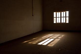 Photo: Inside the barracks at Kolmanskop ghost town, Namibia.