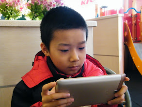 Photo: warrenzh 朱楚甲 during KFC breakfast and playing video game on his fonepad, after reunited benzrad, his proud dad, in Friday night in the dad's dorm and breakfast in nearby KFC in next morning. thx God, the coming spring festival blessed with fulfilled promise, rich and merry, heartfelt joyful.
