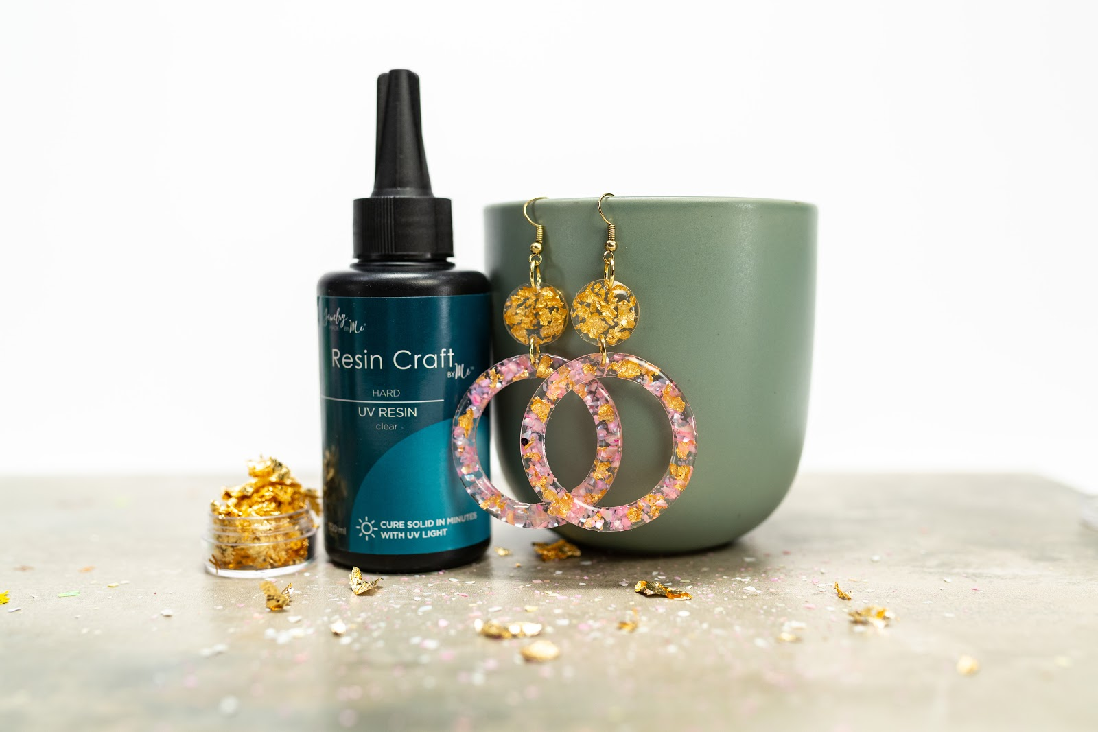 Lifestyle product photography highlighting Jewelry Made by Me's resin and sample earrings.
