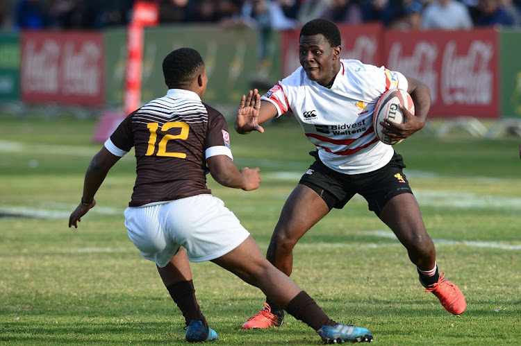 Yanga Hlalu of the Golden Lions is tackled by Sinethemba Qeshile at St Stithians College on July 17 2017 in Johannesburg. Picture: LEE WARREN/GALLO IMAGES