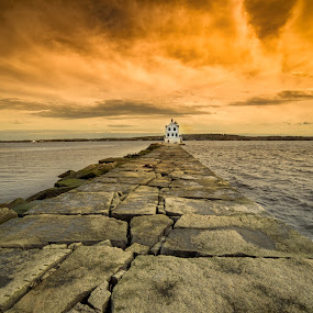 Approach the Lighthouse by Ronnie Sue Ambrosino - Landscapes Waterscapes ( building, maine, breakwater, light house, lighthouse, rocks, rockland,  )