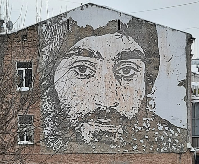 Portrait of Serhiy Nigoyan, the hero of Heavenly Hundred, on the wall of one of the houses on Mykhailivs'ka Street, Kyiv