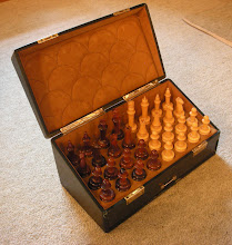 Photo: CH294 - the interior, with pieces in situ.  The interior is nicely padded with a very soft leather, with separate wells that fit each piece (the bases are virtually identical in size); the lid slopes down towards the front. At first sight, it would seem that the box is purpose-made for the set - but, the pieces do not entirely stay in place with the lid closed, so this is by no mean certain.  The pieces look to be made of catalin - a phenolic resin, and the successor to bakelite. Each piece is made of two sections - the base and 'the rest'. Unlike other sets of this material that I have, or have seen/discussed, the two sections are joined neither by threaded pegs of the same material nor by metal screws, but - for the few that I have been able to prise apart - simply push together for a remarkably snug fit.  A few pieces needed some repair work - this was very ably done, in a notoriously tricky medium, by Milissa Ellison, who is US-based and can be contacted on this e-mail: milissa.ellison@yahoo.com.