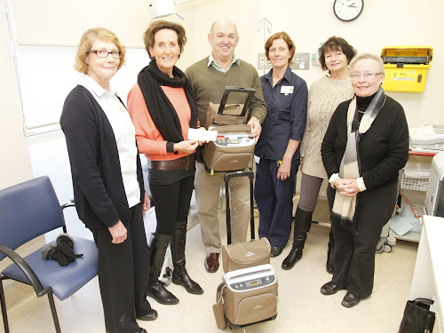Killarney Bike Classic committee members with Paul Thomas representing major sponsor Landmark, from left, Narrabri Health Services Community Health Service Nurse Unit Manager  Cathy Leys, committee secretary Pam Waters, Mr Thomas, Palliative Care Register Nurse Gillian Hudson, Liz Campbell and committee treasurer Annie Lampe with the two portable oxygen concentrators presented to the hospital.