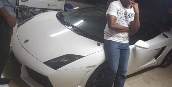 The OR Tambo heist suspect poses with the R5m Lamborghini. His face has been cropped out of the picture as he cannot be identified until he has pled to charges. Picture: ZIMBABWE TODAY