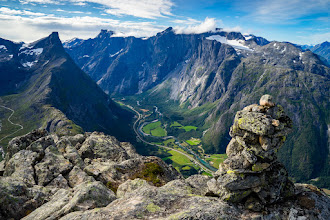 """Photo: The valley Romsdalen, seen from the peak Blånebba, along the hiking route Romsdalseggen (""""Romsdal Edge""""). Romsdalshorn, the peak to left, is one of Norway's most popular climbing mountains."""