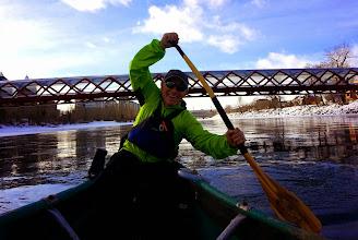 Photo: Captain Rum haulin' ass in the rear of the ice canoe