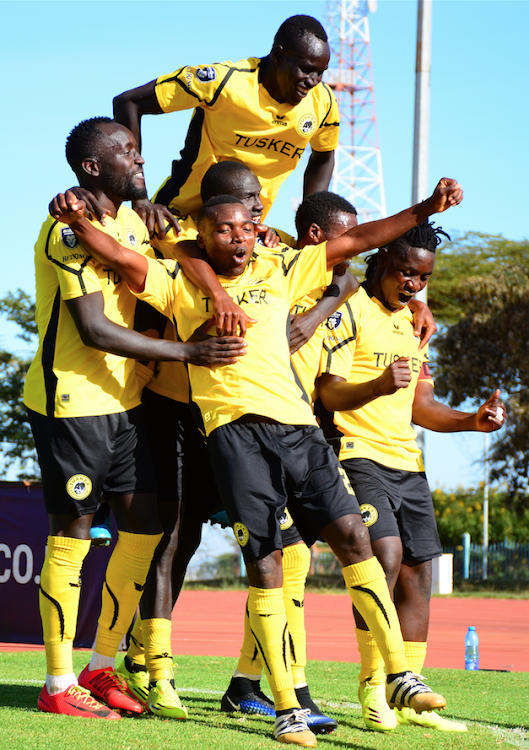 Tusker FC players celebrate their goal against Mathare United during their Premier League match at Kasarani Annex. FKF announced all league matches have been suspended following President Kenyatta's directive