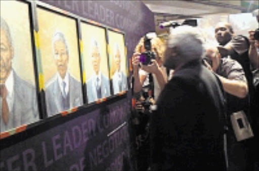 PAYING HOMAGE: Archbishop Desmond Tutu, a favourite of the media, visits the exhibition. 08/11/08. © Unknown.