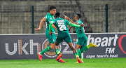 Subsiso Mobilise and Thembela Sikhakhane of AmaZulu FC runs towards Emiliano Tade of AmaZulu FC to congratulate him on scoring the first goal during the Telkom Knockout Cup Last 16 Amazulu FC and Cape Town City FC on the 23 October 2018 at King Zwelithini Stadium,Durban.