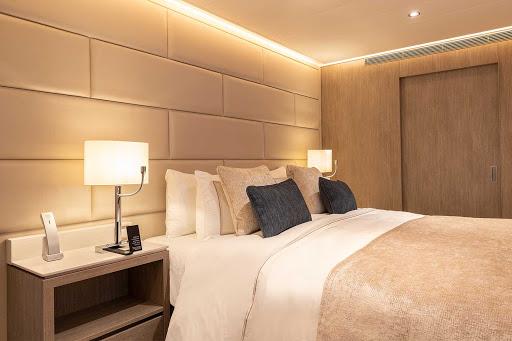Bedroom-detail-Deluxe-Veranda-Suite-Silver-Origin.jpg - A detail of the bedroom in the Deluxe Veranda Suite aboard Silver Origin.