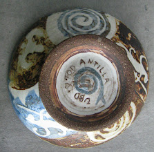 Photo: test bowl #1. glaze fired 'ox blood- clear' and clear gersley borate wash over fired on pigmented slips