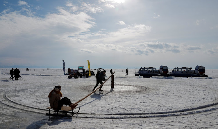 People enjoy good weather on the Lake Baikal in Russia.