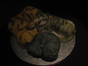 Photo: One of the wedding cakes was... cats!