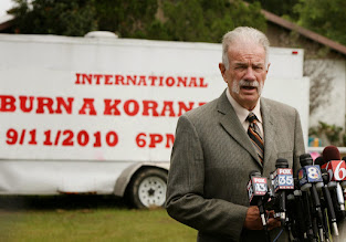 Photo: Pastor Terry Jones tells members of the media he plans to go forward with plans to burn Qurans at the Dove World Outreach Center in Gainesville, Wednesday, September 8, 2010. Church members plan to burn copies of the Quran on September 11. (Stephen M. Dowell/Orlando Sentinel/MCT)
