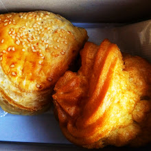 Photo: A little snack on Mekong Express.  Cream puff and a pastry with...fish in it.  No thanks.