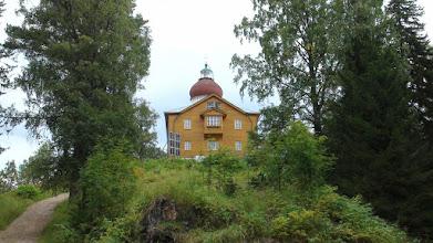 Photo: Келейный корпус деревянный и Церковь Вознесения Господня