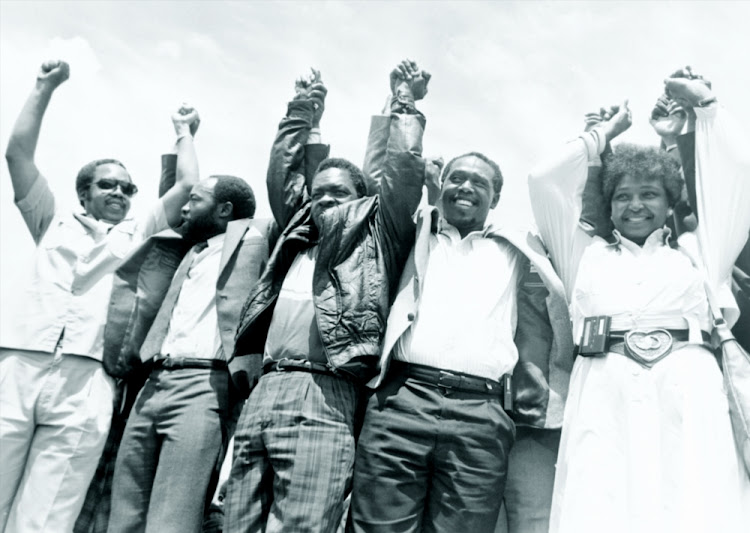ANC, PAC, IFP and Azapo leaders stand together at a peace rally in Bekkersdal in the early 1990s. On the right is Winnie Mandela and next to her is Tokyo Sexwale.