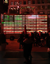 Photo: Neon Flag @ Times Square. Not quite sure what everyone is looking it. I think it's the ads.