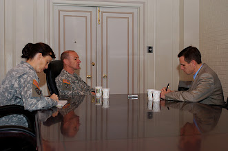 Photo: Brig. Gen. Ed Cardon, CGSC Deputy Commandant, conducts an interview with Associate Press reporter John Milburne, right, while CGSC public affairs officer Lt. Col. Stacy Bathridge takes notes. Milburne attended the ethics symposium at the Frontier Conference Center, Nov. 17 and 18.