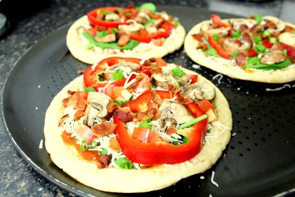 Lightly brush pizza crust with olive oil.  Top with marinara and sprinkle the...