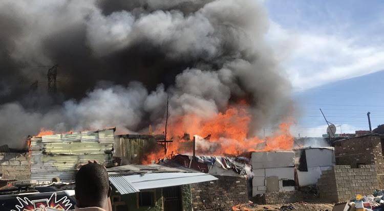 A fire that swept through Alexandra township destroyed more than 600 homes on Thursday afternoon.