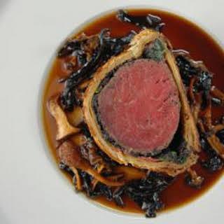 Beef Wellington with wild mushroom Madeira sauce.
