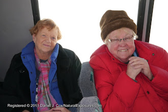 Photo: Ellen Heck and Carolyn Langewisch enjoy some down time on our snow coach. Yellowstone National Park, Wyoming.