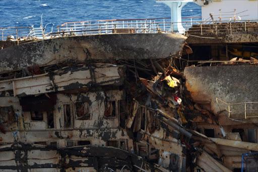 Costa Concordia Cruise Ship Hoisted Upright - Cruise ship damaged