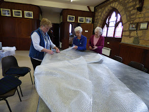 Photo: spreading bubblewrap on the table ready to have the felt placed on top