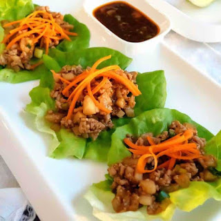 Easy Asian Chicken Lettuce Wraps with Spicy Dipping Sauce.